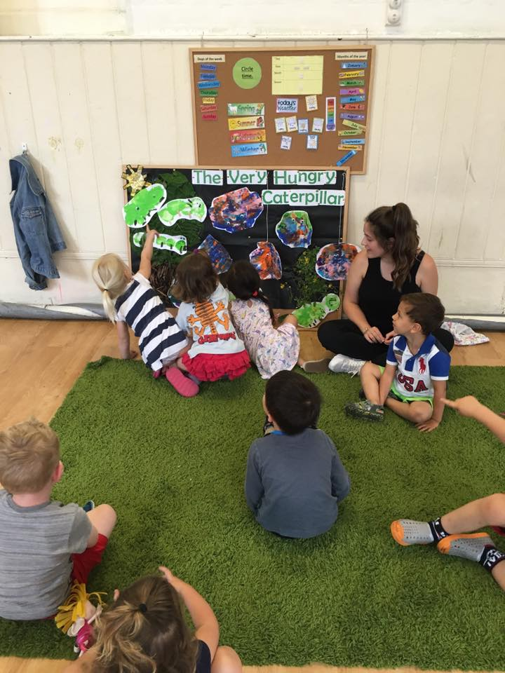Children learning about the very hungry caterpillar