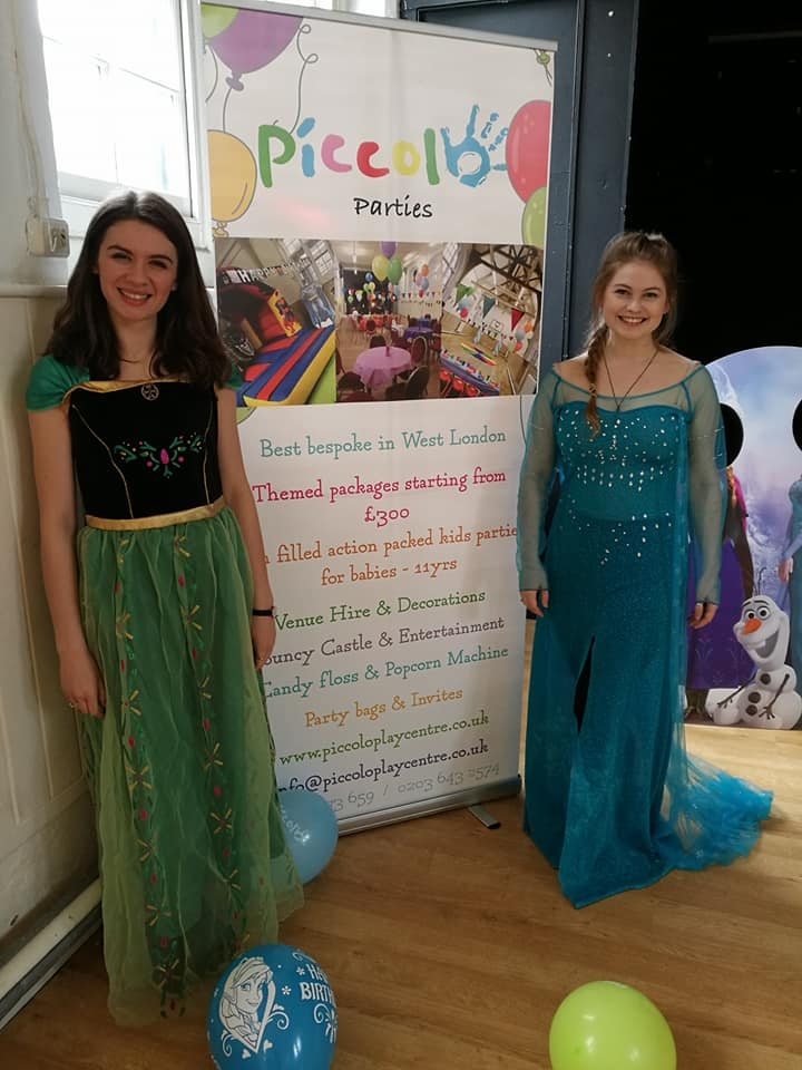 Princesses In front of a banner