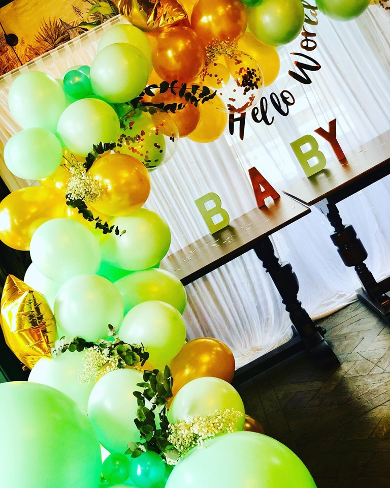 Green and gold balloons for a baby shower
