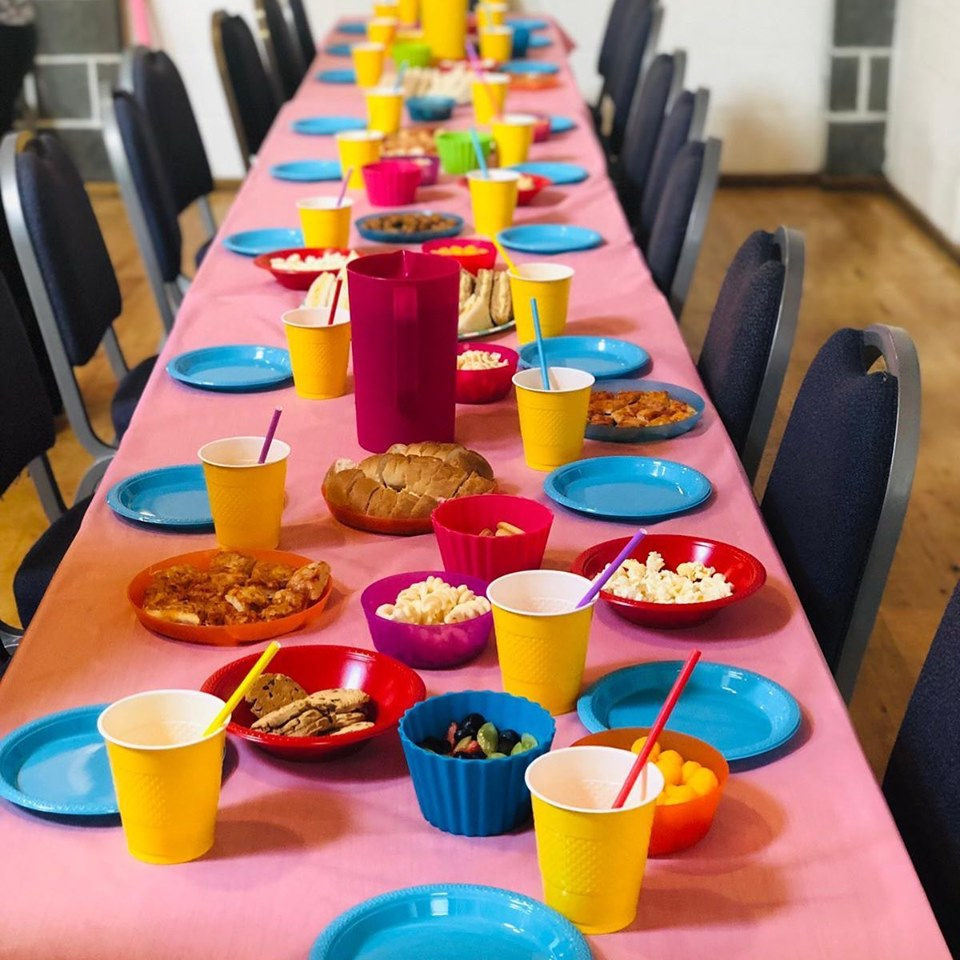 Colourful tableware set up for a children's party